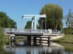 225 117-1 und 225 073-6 beim Überqueren des Ems-Jade-Kanal`s mit Ihrem Kohlezug vom Massenschüttgutlager Wilhelmshaven in Richtung Sande. 02/09/2014